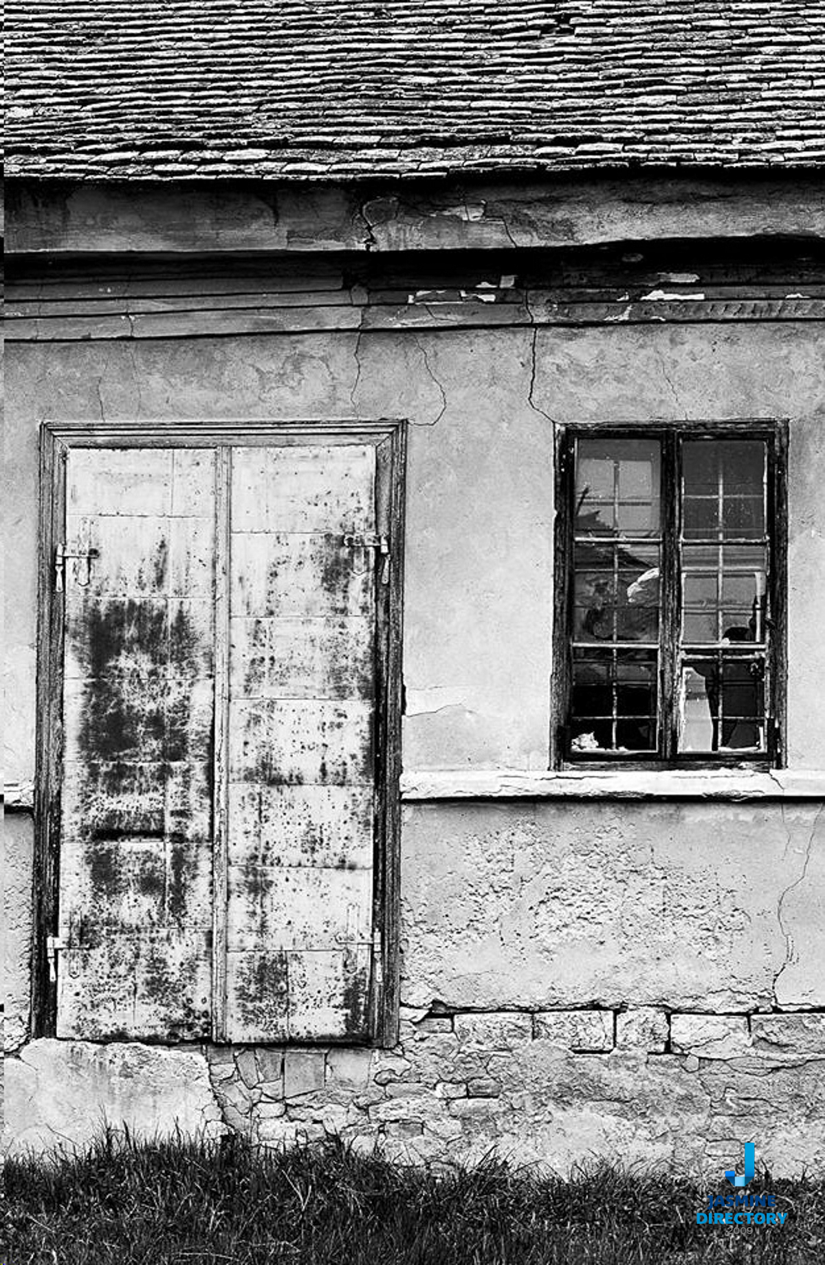 Asymmetrical Balance on an old house with a door and window