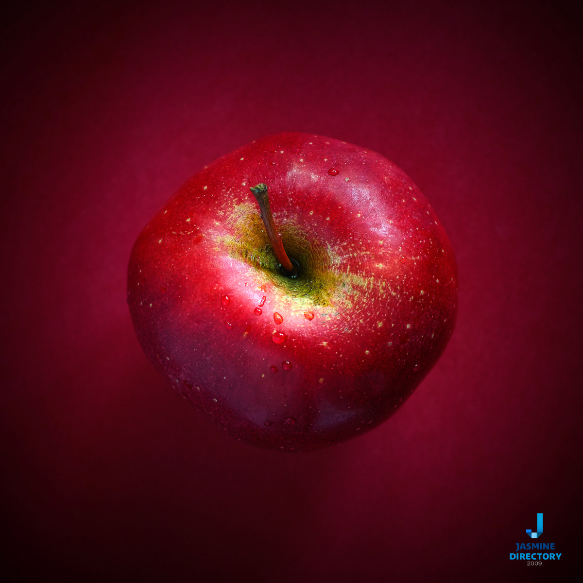 Red apple on red background