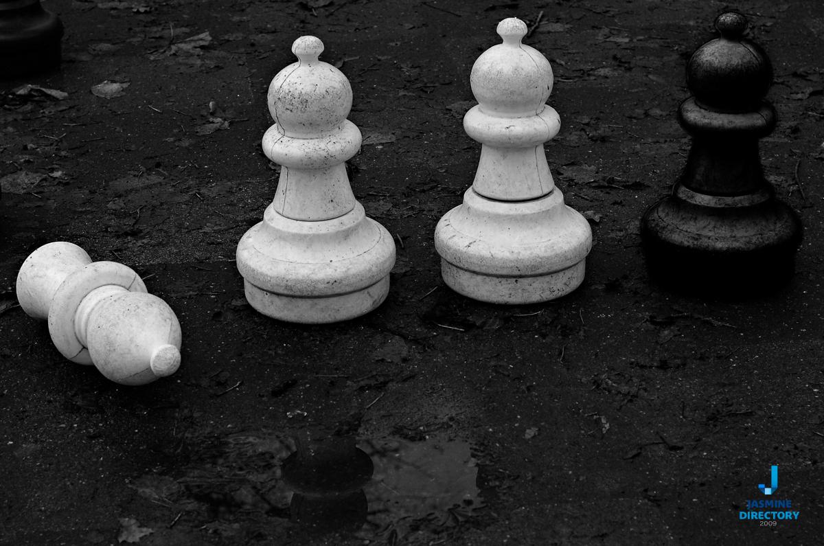 White chess on black background