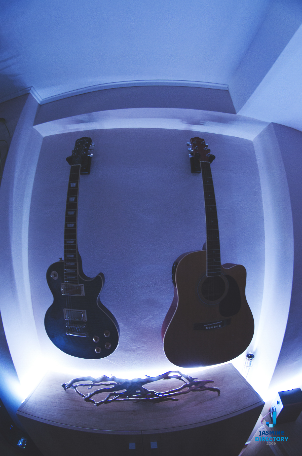 Two guitars forming a simetrical photograph