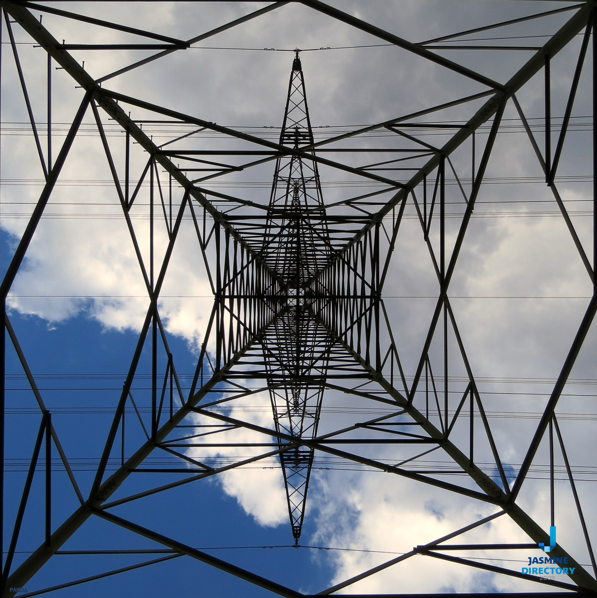 An electricity tower and clouds