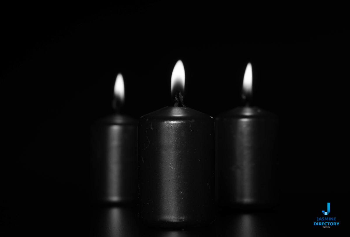 Three candles, white on black